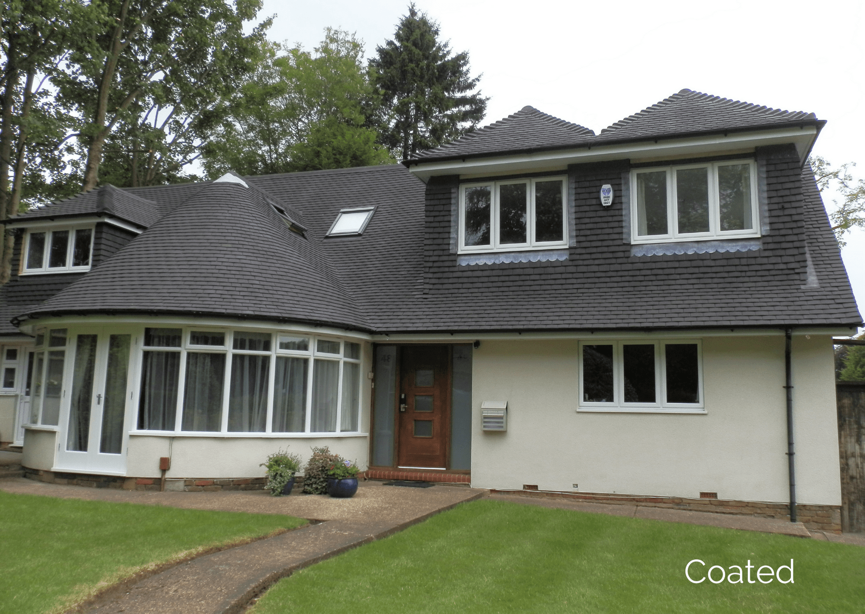 A house that has had the roof treated with the waterproof roof paint